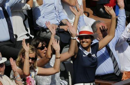 (L-R) Former tennis great Chris Evert, Paris Mayor Anne Hidalgo, French Women Rights, Youth and Sports Minister Najat Vallaud-Belkacem and French Tennis Federation (FFT) President Jean Gachassin watch the women's singles final match between Maria Sharapova of Russia and Simona Halep of Romania at the French Open tennis tournament at the Roland Garros stadium in Paris June 7, 2014. REUTERS/Jean-Paul Pelissier