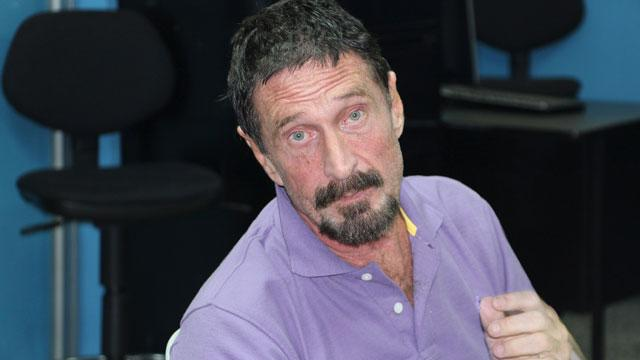 McAfee Out of Hospital, Back in Cell
