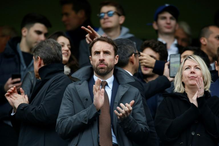 England manager Gareth Southgate (C) attends the English Premier League football match between Chelsea and Arsenal, at Stamford Bridge in London, on February 4, 2017