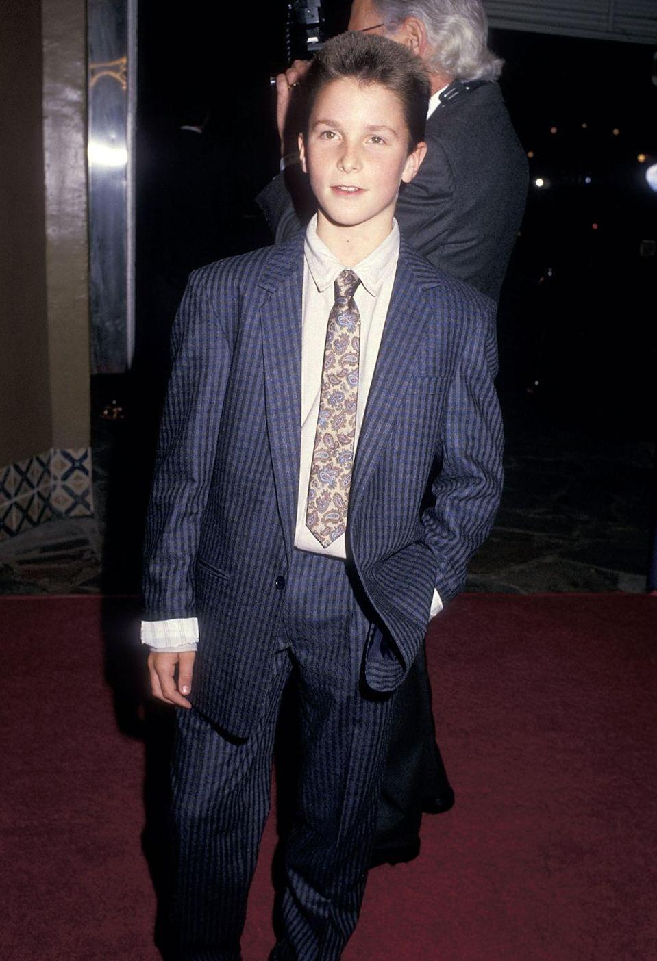 <p>Long before his days as <em>Batman</em>, Christian Bale banked some serious hours on the red carpet as a child actor. The actor served up his now-signature smile when he attended the premiere for his film <em>Empire of the Sun </em>in 1987. </p>