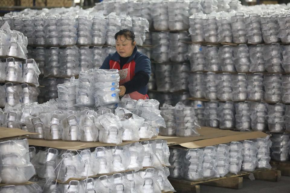 HANGZHOU, CHINA - MARCH 31 2020: An employee works in a factory of kitchenwares in Hangzhou in east China's Zhejiang province Tuesday, March 31, 2020.- PHOTOGRAPH BY Feature China / Barcroft Studios / Future Publishing (Photo credit should read Feature China/Barcroft Media via Getty Images)