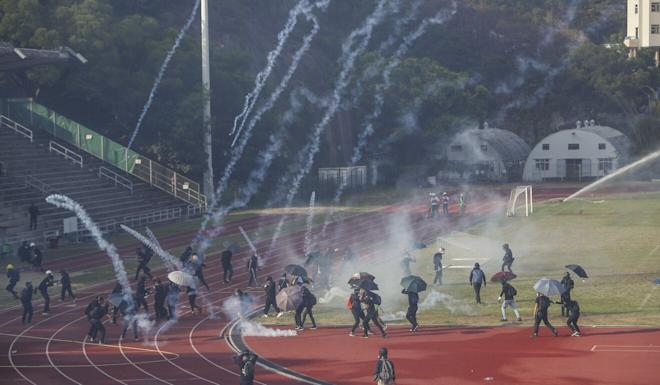 Police fire tear gas rounds at protesters on the Sir Philip Haddon-Cave Sports Field on the campus of Chinese University last November. Photo: Winson Wong