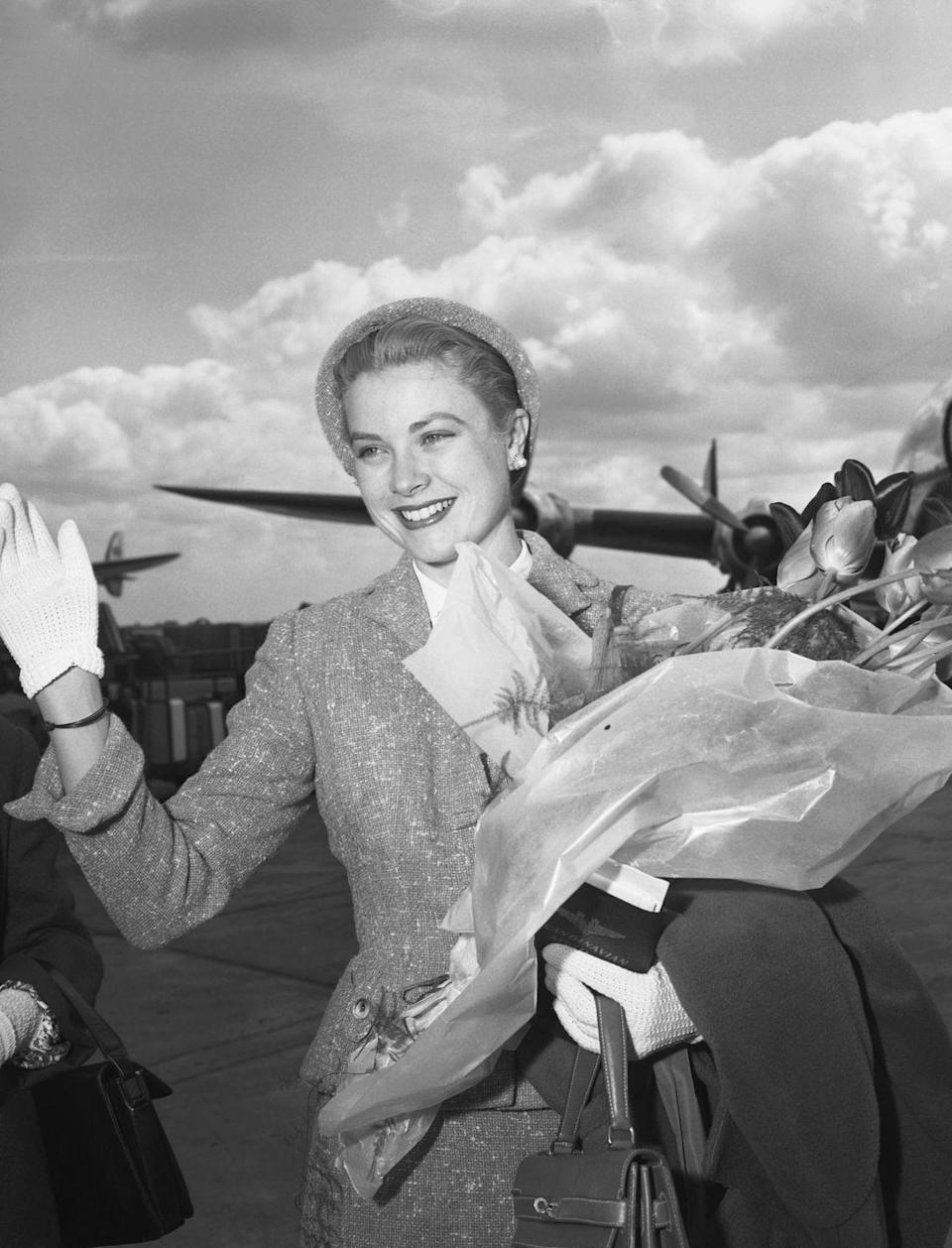<p>The actress-turned-princess waves to the public as she arrives in Paris. Only royalty can look that good after an international flight.</p>