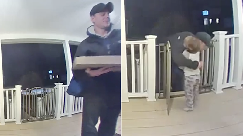 Little boy Cohen, from Rhode Island in the US, hugs pizza delivery man Ryan Catterson who recently lost his daughter.