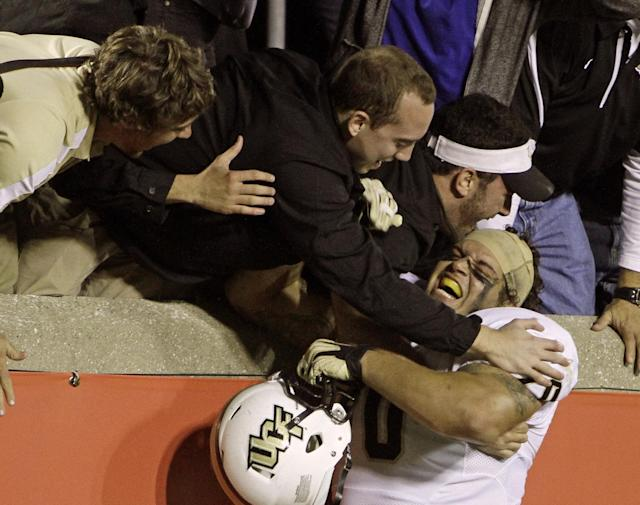 Central Florida's Chris Martin celebrates with fans after UCF upset No. 8 Louisville 38-35 in an NCAA college football game in Louisville, Ky., Friday, Oct. 18, 2013. (AP Photo/Garry Jones)
