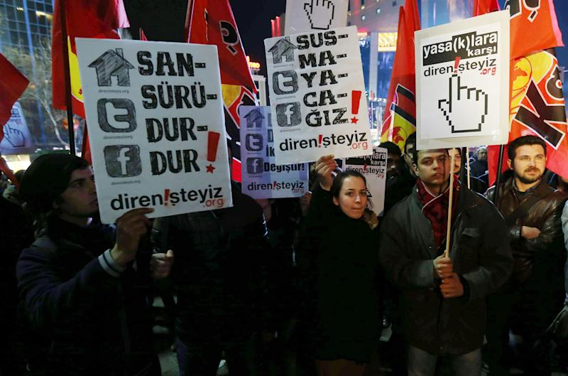 """Protesters hold a placard reading """"Stop the censorship!"""" as they demonstrate against new controls on the Internet approved by the Turkish parliament, in Ankara on February 8, 2014"""
