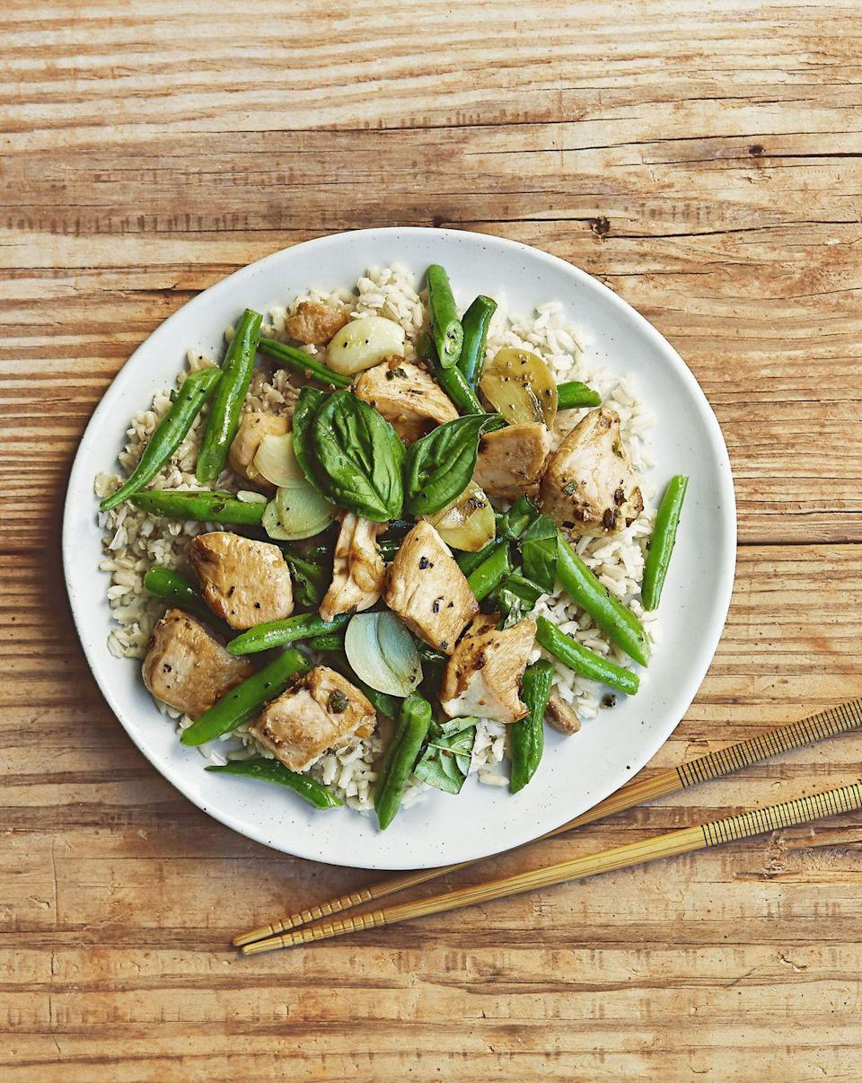 """<p>Stir fry is always a good idea — especially when there's basil leaves and green beans involved.</p><p><em><em><a href=""""https://www.goodhousekeeping.com/food-recipes/a38391/basil-chile-chicken-stir-fry-recipe/"""" rel=""""nofollow noopener"""" target=""""_blank"""" data-ylk=""""slk:Get the recipe for Basil Chile Chicken Stir-Fry »"""" class=""""link rapid-noclick-resp"""">Get the recipe for Basil Chile Chicken Stir-Fry »</a></em></em></p>"""