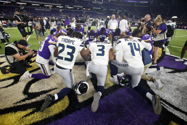 Players kneel on the field after an NFL preseason football game between the Minnesota Vikings and the Seattle Seahawks, Sunday, Aug. 18, 2019, in Minneapolis. The Vikings won 25-19. (AP Photo/Bruce Kluckhohn)