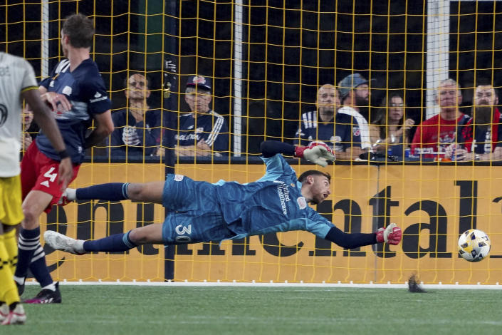 New England Revolution goalkeeper Matt Turner (30) can't make the save on a goal by Columbus Crew forward Gyasi Zerdes during the second half of a MLS soccer match, Saturday, Sept. 18, 2021, in Foxborough, Mass. (AP Photo/Mary Schwalm)