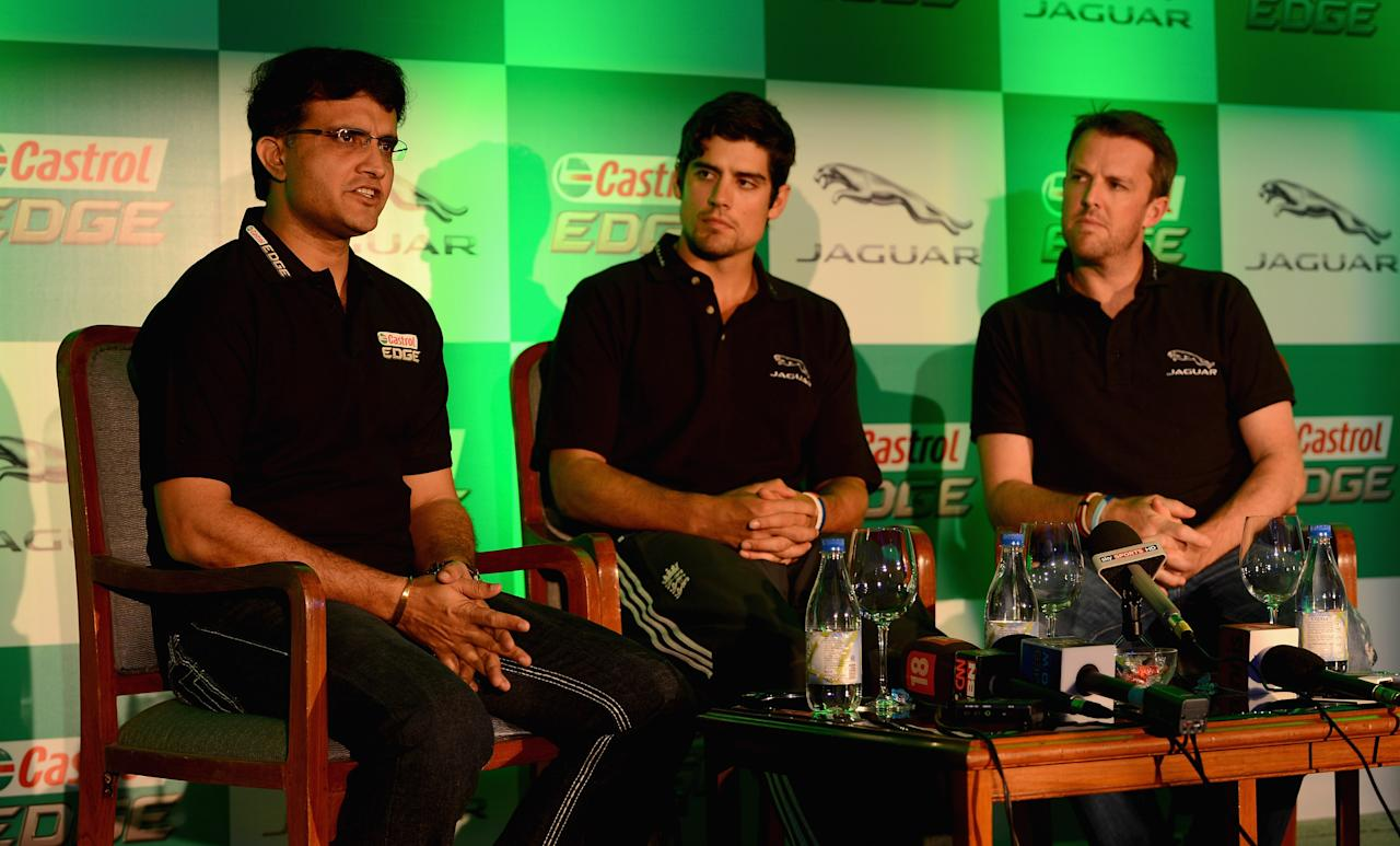 MUMBAI, INDIA - NOVEMBER 02:  England captain Alastair Cook and Graeme Swann listen to former Indian cricketer Sourav Ganguly during a press conference to promote Jaguar and Castrol Edge at the Trident Hotel on November 2, 2012 in Mumbai, India.  (Photo by Gareth Copley/Getty Images)
