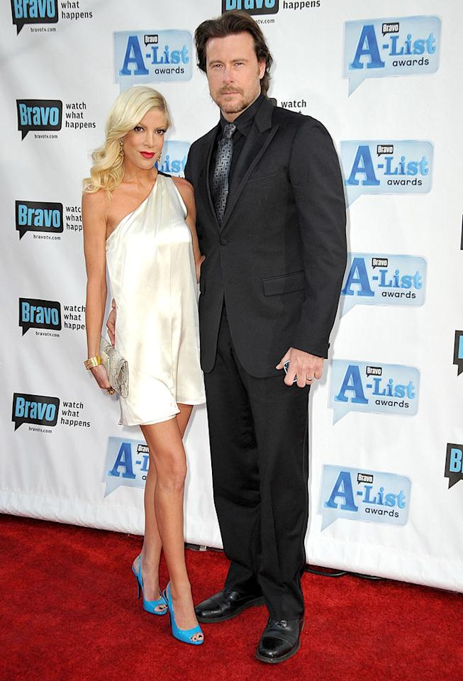 "Tori Spelling's bright blue heels added a splash of color to her cream one-shoulder frock, while hubby Dean McDermott rocked black from head-to-toe. Jordan Strauss/<a href=""http://www.wireimage.com"" target=""new"">WireImage.com</a> - April 5, 2009"