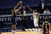 Indiana's Malcolm Brogdon takes a shot in the Pacers' NBA overtime win over the New Orleans Pelicans
