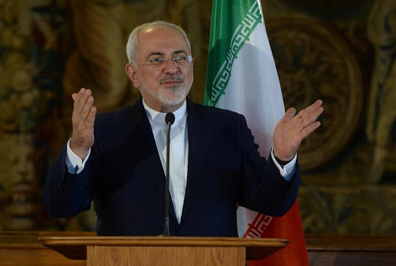Iranian Foreign Minister Mohammad Javad Zarif gestures during a press conference in Prague on November 11, 2016