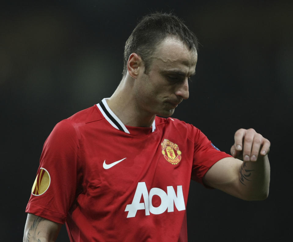 MANCHESTER, ENGLAND - FEBRUARY 23:  Dimitar Berbatov of Manchester United shows his disappointment at being substituted during the UEFA Europa League round of 32 second leg match at Old Trafford on February 23, 2012 in Manchester, England.  (Photo by John Peters/Manchester United via Getty Images)