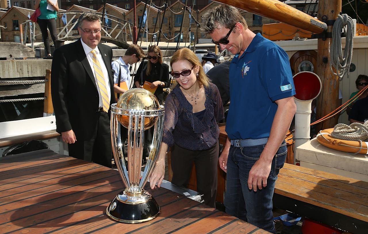 SYDNEY, AUSTRALIA - OCTOBER 02:  (L-R) Cricket World Cup 2015 CEO John Harnden, Brett Lee and NSW Minister for Sport Gabrielle Upton look at the ICC Cricket World Cup trophy during celebrations to mark 500 days to go until the 2015 ICC Cricket World Cup on October 2, 2013 in Sydney, Australia.  (Photo by Mark Metcalfe/Getty Images for the ICC)