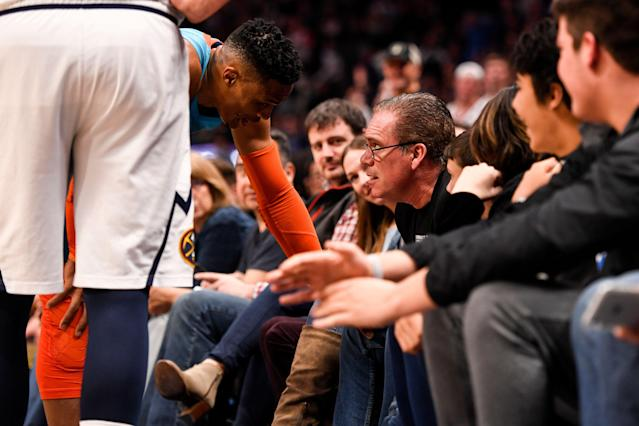 Russell Westbrook of the Oklahoma City Thunder has words with a fan seated courtside against the Denver Nuggets during the third quarter on Tuesday. (Photo by AAron Ontiveroz/MediaNews Group/The Denver Post via Getty Images)