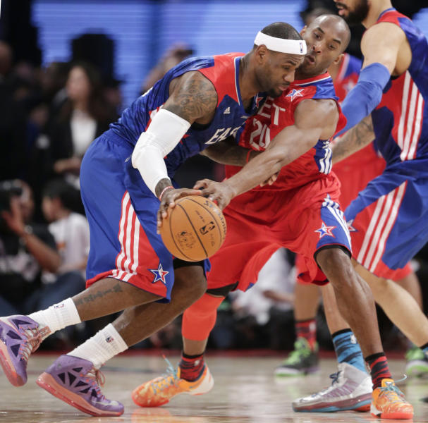 East Team's LeBron James of the Miami Heat is defended by West Team's Kobe Bryant of the Los Angeles Lakers during the first half of the NBA All-Star basketball game Sunday, Feb. 17, 2013, in Houston. (AP Photo/Eric Gay)