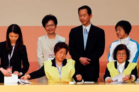 Carrie Lam smiles as officials count votes during the election for Hong Kong's next Chief Executive in Hong Kong