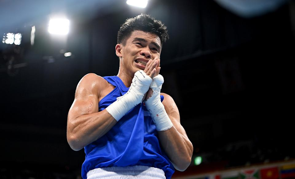 TOKYO, JAPAN - AUGUST 03: Carlo Paalam of Team Philippines celebrates vicrory over Shakhobidin Zoirov of Team Uzbekistan during the Men's Fly (48-52kg) quarter final on day eleven of the Tokyo 2020 Olympic Games at Kokugikan Arena on August 03, 2021 in Tokyo, Japan. (Photo by Luis Robayo - Pool/Getty Images)