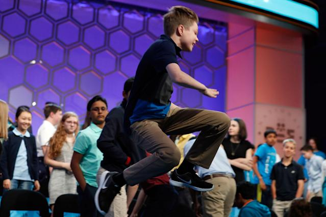 <p>Will Rooke, 13, from Deephaven, Minn., jumps off the stage after the second round of the 90th Scripps National Spelling Bee, Wednesday, May 31, 2017, in Oxon Hill, Md. (AP Photo/Alex Brandon) </p>