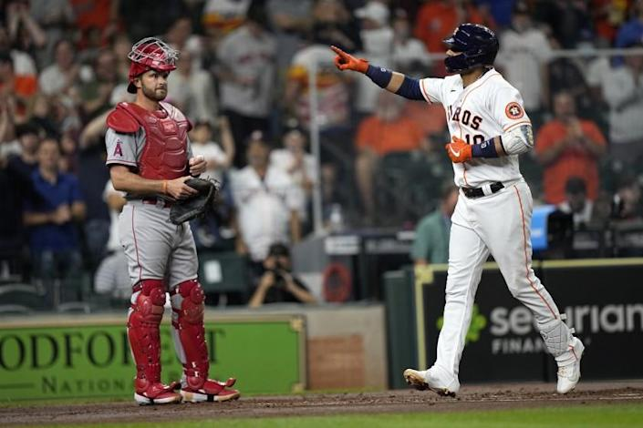 Houston Astros' Yuli Gurriel (10) celebrates after hitting a two-run home run as Los Angeles Angels catcher Drew Butera.