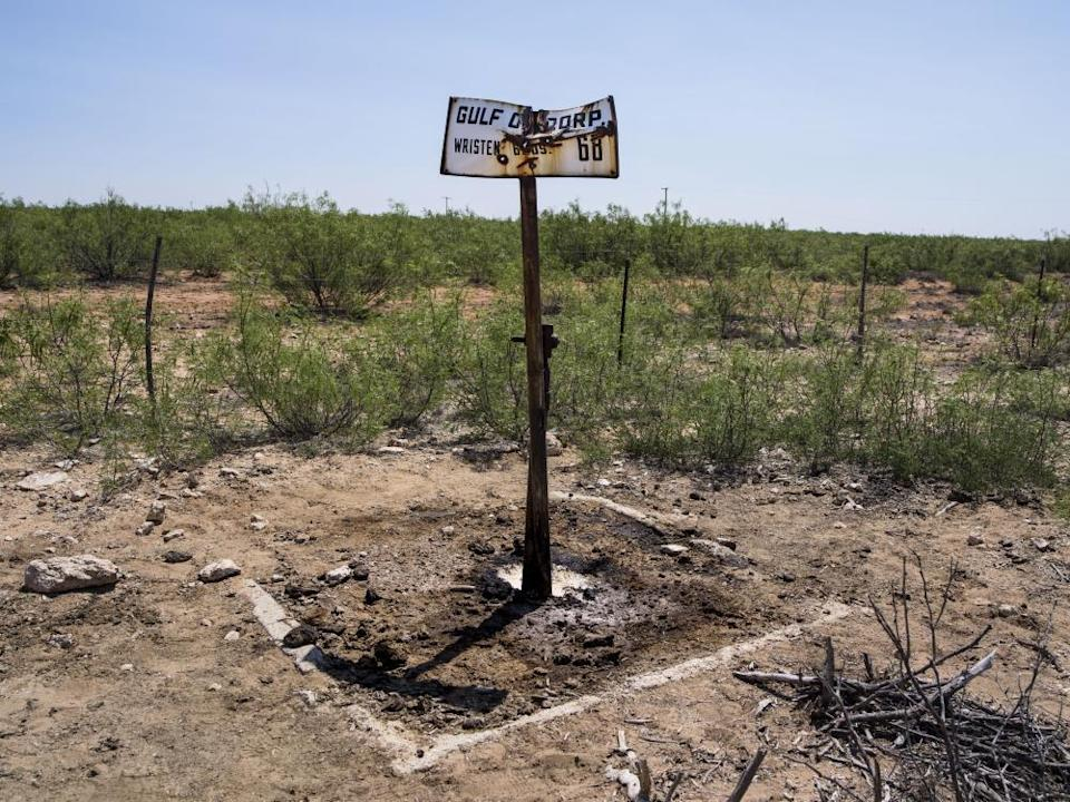 A plugged and abandoned oil well once owned by Gulf Oil, later acquired by Chevron, leaks contaminants to the surface at a cattle ranch in Crane County, Texas. Millions of defunct wells are aging by the day and increasingly springing leaks.