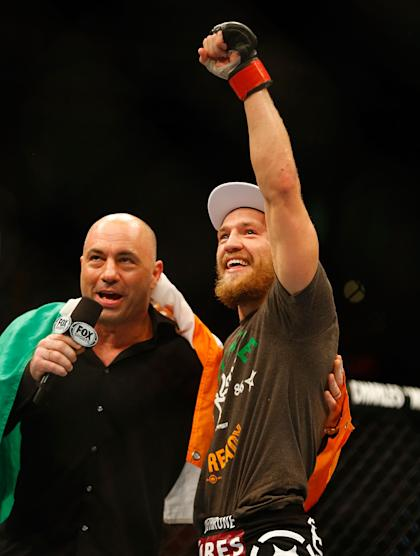Dana White pulled Conor McGregor, shown being interviewed by Joe Rogan in the cage after a fight, from the UFC 200 card. (Getty Images)