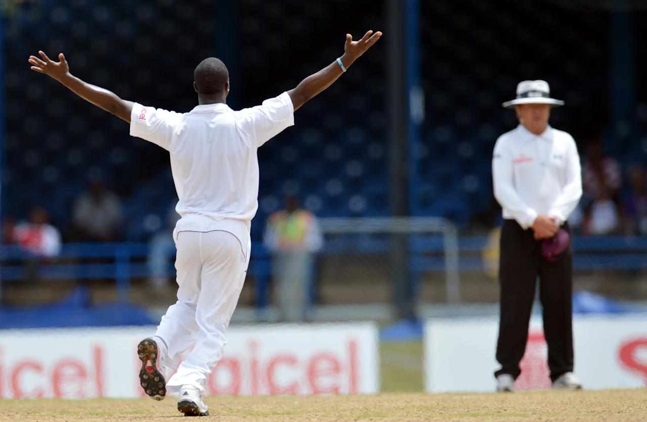 West Indies bowler Kemar Roach (L) appeals for lbw against Australian batsman Ed Cowan during the fourth day of the second-of-three Test matches between Australia and West Indies April 18, 2012 at Queen's Park Oval in Port of Spain, Trinidad. West Indies won appeal on review.