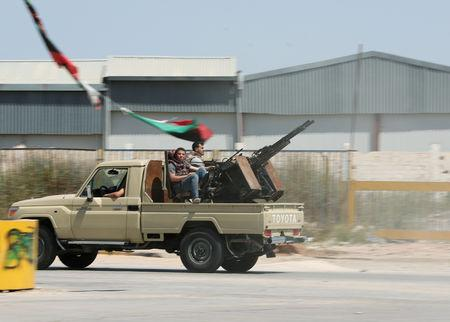 Members of the Libyan internationally recognised government forces are seen in Al-Swani area in Tripoli