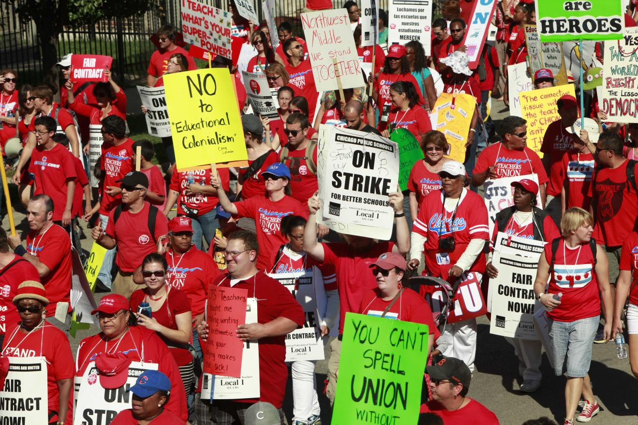 Striking Chicago school teachers march after a rally Saturday, Sept. 15, 2012 in Chicago. Thousands of striking Chicago public school teachers and their allies packed a city park Saturday in a boisterous show of force as union leaders and the district tried to work out the details of an agreement that could end a week-long walkout.(AP Photo/Sitthixay Ditthavong)