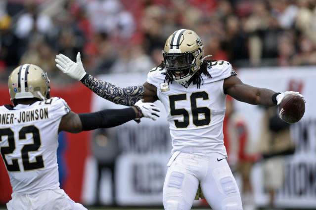 New Orleans Saints outside linebacker Demario Davis (56) celebrates with defensive back Chauncey Gardner-Johnson (22) after Davis intercepted a pass by the Tampa Bay Buccaneers during the first half of an NFL football game Sunday, Nov. 17, 2019, in Tampa, Fla. (AP Photo/Jason Behnken)