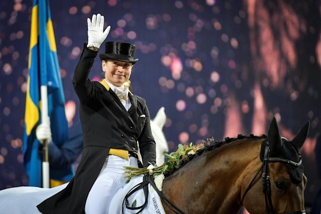 Equestrian - Sweden International Horse Show - Fei Grand Prix Dressage Qualification Event - Friends Arena, Stockholm, Sweden - December 2, 2017. Isabell Werth of Germany celebrates on her horse Emilio 107 after winning. TT News Agency/Jessica Gow via REUTERS ATTENTION EDITORS - THIS IMAGE WAS PROVIDED BY A THIRD PARTY. SWEDEN OUT. NO COMMERCIAL OR EDITORIAL SALES IN SWEDEN