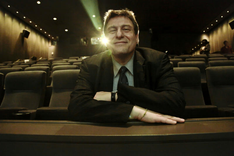 This Sept. 13, 2012 photo shows Richard Pena, director of the New York Film Festival (NYFF), posing inside the Lincoln Center Theater in New York. Pena will step down as head of the Film Society of Lincoln Center and the NYFF after this year's 50th Anniversary of NYFF presentation. (AP Photo/Bebeto Matthews)
