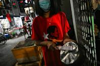 Residents of Yangon protest against the military coup by making noise with pots and pans