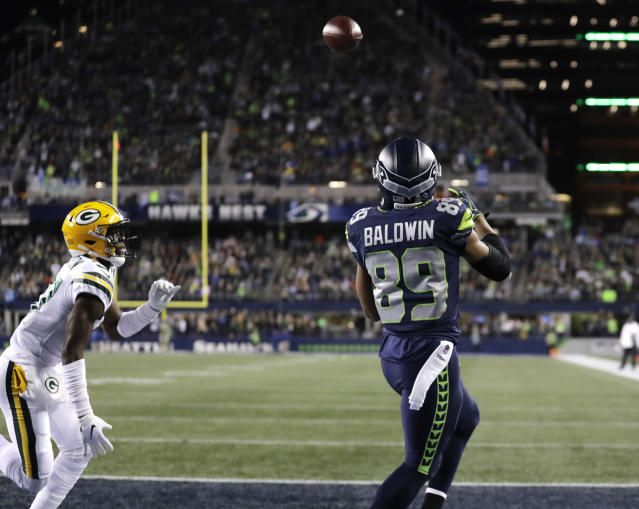 Seattle Seahawks wide receiver Doug Baldwin (89) catches a pass for a touchdown in front of Green Bay Packers cornerback Josh Jackson, left, during the first half of an NFL football game Thursday, Nov. 15, 2018, in Seattle. (AP Photo/Stephen Brashear)