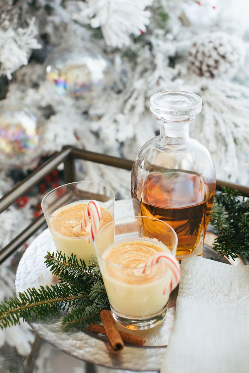 "<p>""Few things say 'holiday' more to me than eggnog. Our family gathers each year to build gingerbread houses, and I always have a classic punch bowl filled for the adults to enjoy."" – Marie Flanigan of <a href=""https://marieflanigan.com/"" rel=""nofollow noopener"" target=""_blank"" data-ylk=""slk:Marie Flanigan Interiors"" class=""link rapid-noclick-resp"">Marie Flanigan Interiors</a>.</p><p><strong>Marie's Eggnog Recipe </strong></p><p><strong>Ingredients:</strong><br>6 egg yolks</p><p>2 cups whole milk</p><p>1 cup heavy cream</p><p>1/4 cup sugar</p><p>1/2 teaspoon vanilla extract</p><p>1/4 teaspoon ground nutmeg</p><p>1/4 teaspoon salt</p><p>3/4 cup brandy</p><p>1/4 cup bourbon </p><p>Cinnamon sticks</p><p><strong>Directions:</strong><br>Beat yolks at medium speed with an electric mixer until frothy. Gradually beat in milk, sugar, vanilla, and nutmeg.<br>Stir in whipping cream, brandy, and bourbon. Chill until you're ready to serve. Garnish each serving with nutmeg sprinkled on top and a cinnamon stick<br><br></p>"