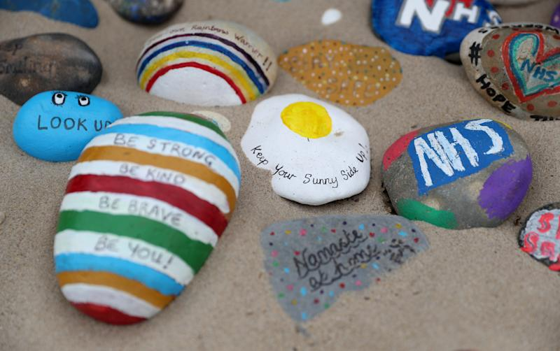 Painted pebbles showing support for the NHS and keyworkers, and containing positive messages, which have been left by members of the public on Avon beach in Christchurch, as the UK continues in lockdown to help curb the spread of the coronavirus. (Photo by Andrew Matthews/PA Images via Getty Images)