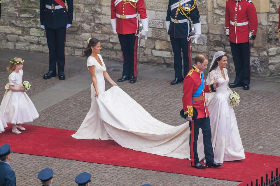 """<p>It was the bridesmaids dress that sent shockwaves around the world: Pippa Middleton wore a <a href=""""https://www.who.com.au/pippa-middletons-bridesmaid-dress"""" rel=""""nofollow noopener"""" target=""""_blank"""" data-ylk=""""slk:slim-fit white dress"""" class=""""link rapid-noclick-resp"""">slim-fit white dress</a> as maid of honor in her sister Kate Middleton's royal wedding to Prince William.</p>"""