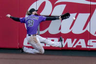 Colorado Rockies right fielder Charlie Blackmon is unable to catch a ground-rule double by St. Louis Cardinals' Nolan Arenado during the second inning of a baseball game Friday, May 7, 2021, in St. Louis. (AP Photo/Jeff Roberson)