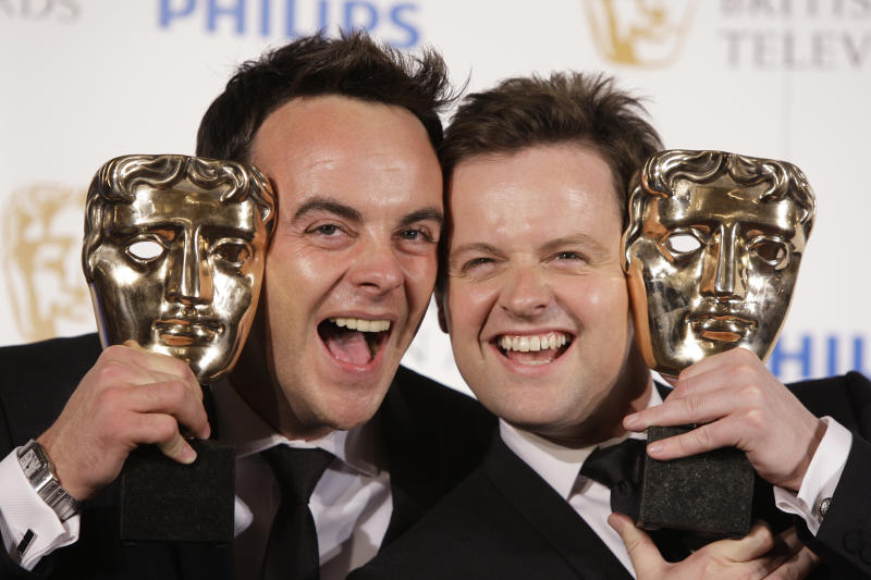 British TV presenters Anthony 'Ant' McPartlin , left and Declan 'Dec' Donnelly, display their Bafta awards, during the British Academy Television Awards, at the London Palladium in central London, Sunday, June 6, 2010. (AP Photo/Joel Ryan)