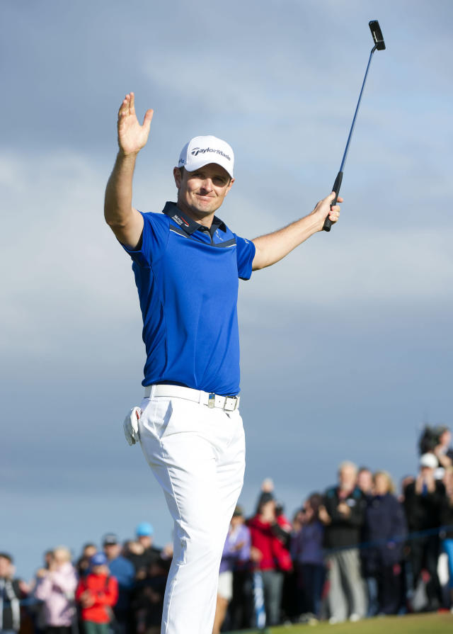 Justin Rose celebrates holing the winning putt to give him the title during day four of the Scottish Open at Royal Aberdeen, Aberdeen, Scotland, Sunday July 13, 2014. (AP Photo/PA, Kenny Smith)