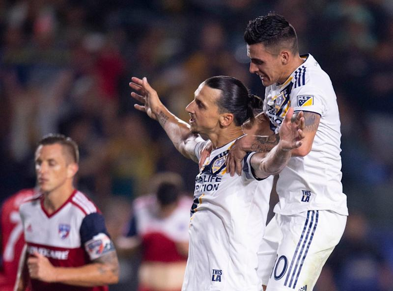 Galaxy star Zlatan Ibrahimovic (center) had nothing but praise for new teammate Cristian Pavon. Major League Soccer is a different story. (Reuters)