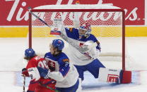Slovakia goalie Samuel Hlavaj (29) makes a save on Czech Republic's Radek Muzik (29) as Slovakia's Juraj Elias (27) defends during the second period of a game leading up to the IIHF World Junior Hockey Championships, Wednesday, Dec. 23, 2020, in Edmonton, Alberta. (Jason Franson/The Canadian Press via AP)