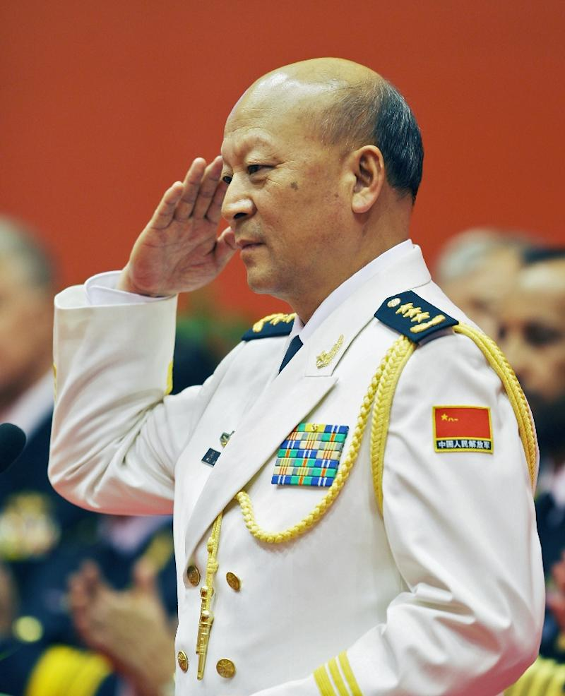 Chinese Naval Commander Admiral Wu Shengli salutes after making speech in Qingdao on April 20, 2009