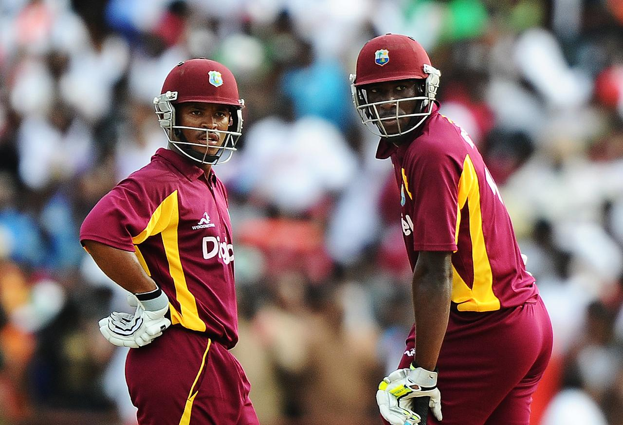 West Indies cricketers Carlton Baugh (L) and Andre Russell confer during the third-of-five One Day International (ODI) matches between West Indies and Australia at the Arnos Vale Ground in Kingstown on March 20, 2012. Australia have scored 220/10 at the end of their innings. AFP PHOTO/Jewel Samad (Photo credit should read JEWEL SAMAD/AFP/Getty Images)