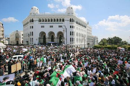 Students take part in a protest seeking the departure of the ruling elite in Algiers