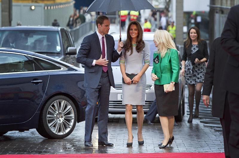 The Duke and Duchess of Cambridge, center, arrive under an umbrella for the UK Premiere of 'African Cats', in aid of 'Tusk Trust', at the BFI Southbank  in central London, Wednesday, April 25, 2012. (AP Photo/Joel Ryan)