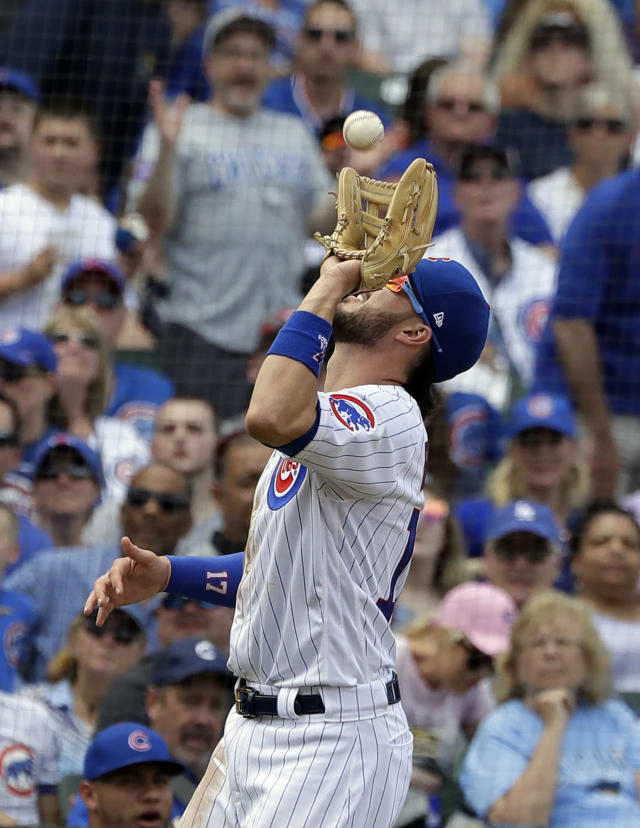 Chicago Cubs third baseman Kris Bryant catches a fly ball hit by Cincinnati Reds' Derek Dietrich in foul territory during the fourth inning of a baseball game Saturday, May 25, 2019, in Chicago. (AP Photo/Nam Y. Huh)
