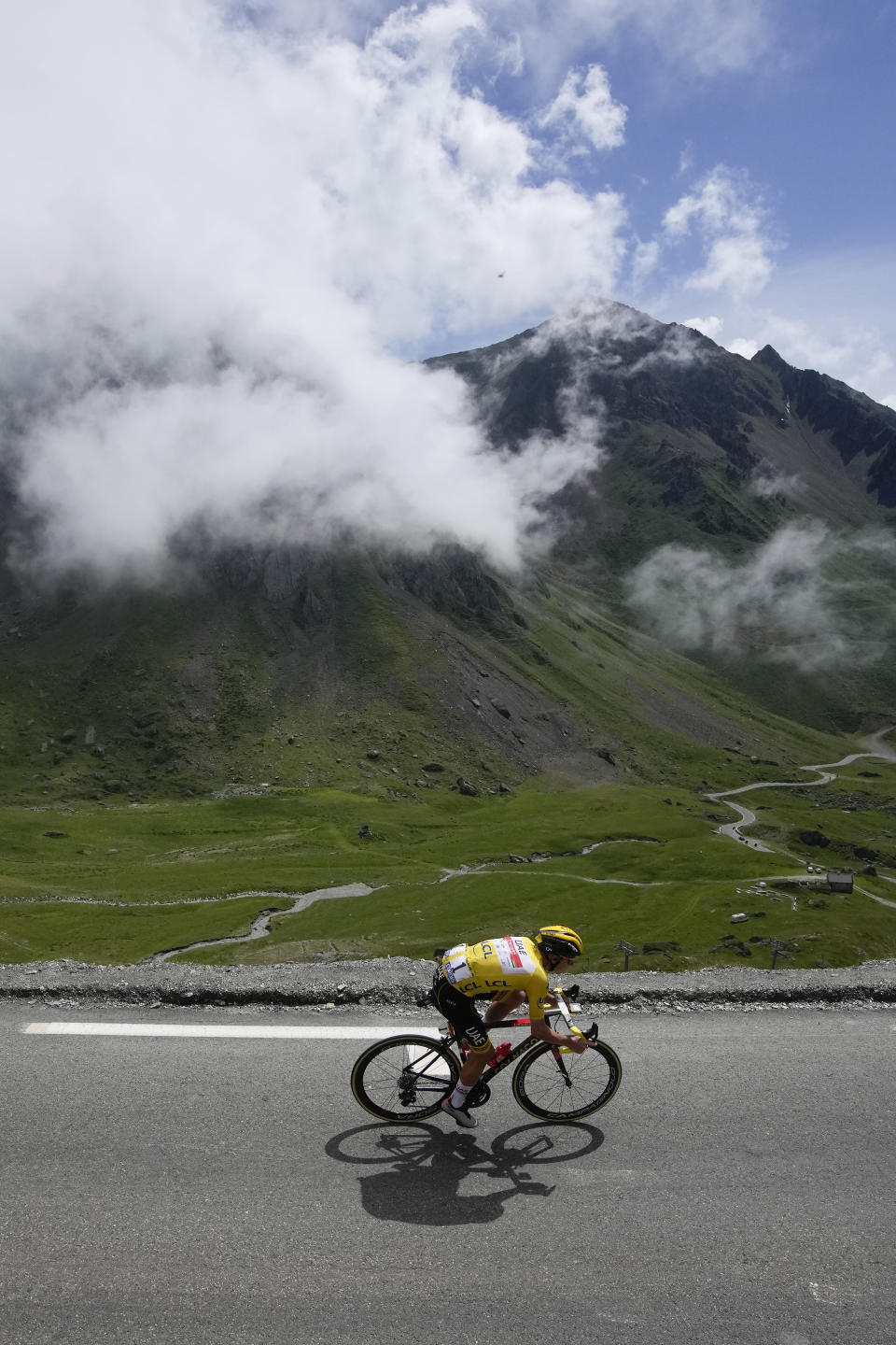 Slovenia's Tadej Pogacar, wearing the overall leader's yellow jersey, speeds down Tourmalet pass during the eighteenth stage of the Tour de France cycling race over 129.7 kilometers (80.6 miles) with start in Pau and finish in Luz Ardiden, France,Thursday, July 15, 2021. (AP Photo/Christophe Ena)