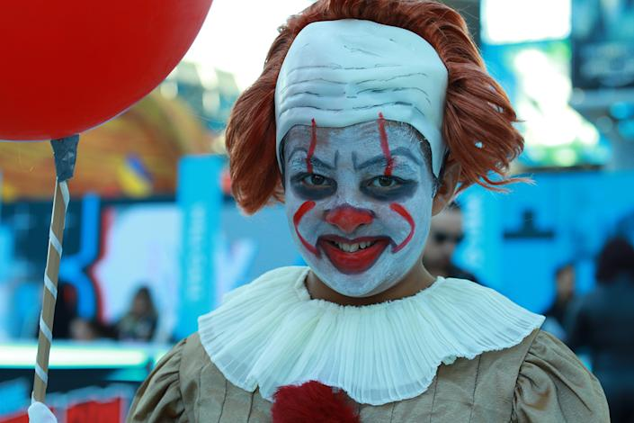A young cosplayer dressed as Pennywise attends the New York Comic Con 2019 at Jacob Javits Center on Oct. 5, 2019 in New York City. (Photo: Gordon Donovan/Yahoo News)